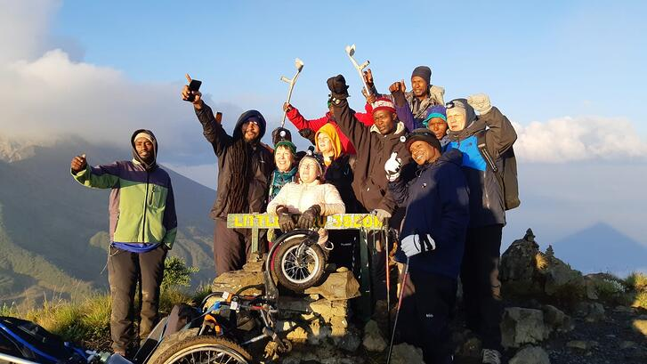Ina Åkerberg and team on top of Mount Meru in a wheelchair