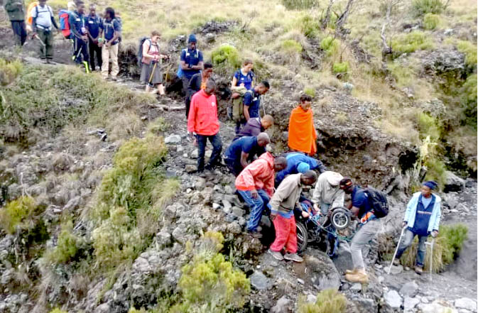 ina descending mount meru with assistance from mountain guides